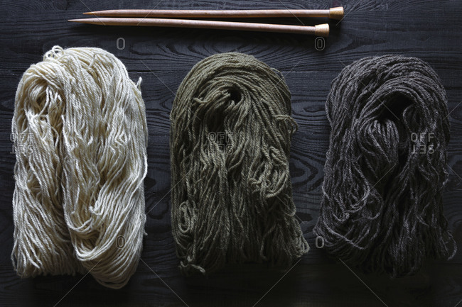 All-natural handspun yarn with knitting needles