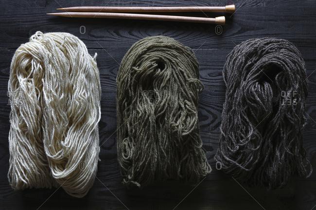 All-natural handspun yarn with knitting needles