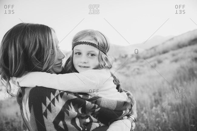Mother holding daughter in black and white