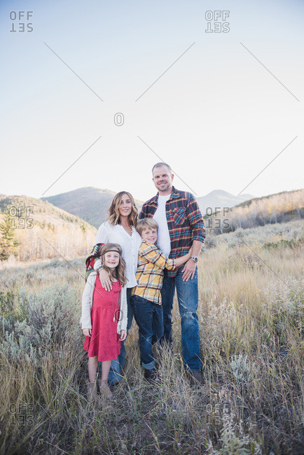 Family fall portrait in a field