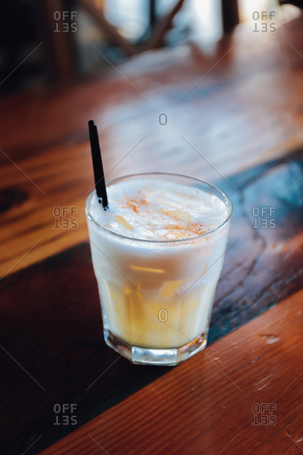 Close up of frothy cocktail served in old fashioned glass