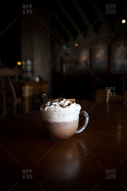 Hot chocolate with whipped cream and a cinnamon stick