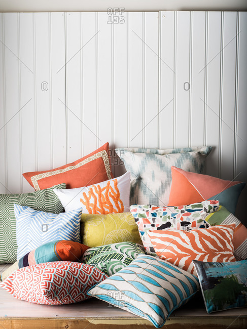 Pile of a variety of throw pillows