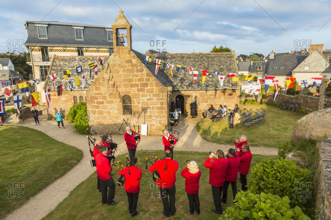 Ploumanach, Cote de Granit Rose, Cotes d'Amor, Brittany, France - May 13, 2015: Pipers performing near the chapel of Saint Guirec in Brittany, France