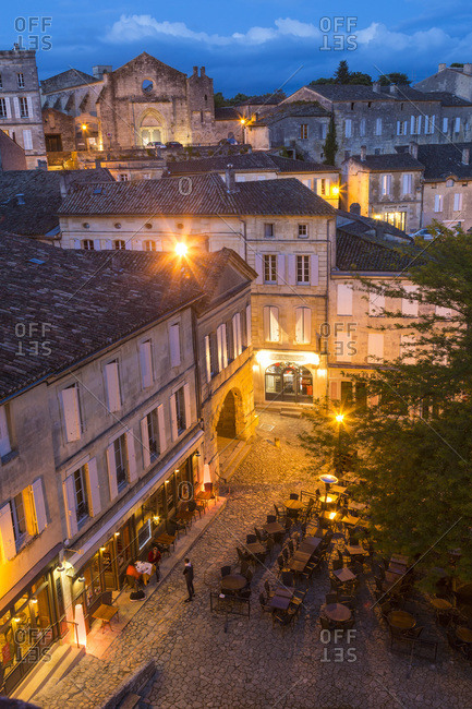 Restaurant in an historic French square at twilight