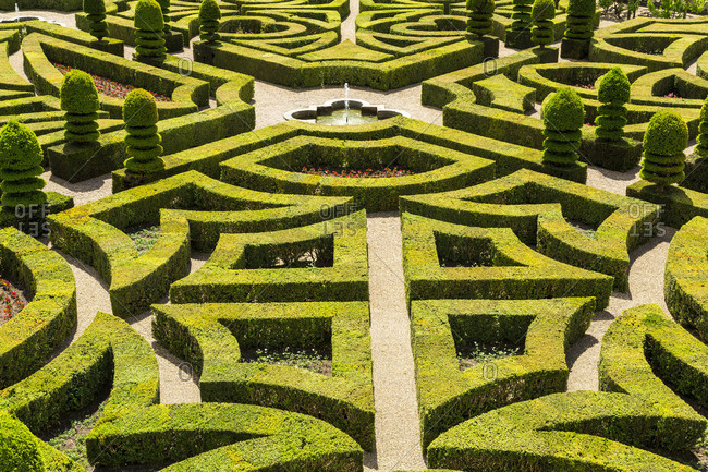 Indre et Loire, Loire Valley, France - June 1, 2015: Fountain and gardens at Chateau de Villandry in France