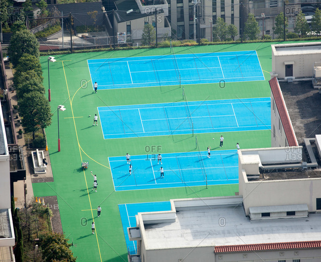 Overhead view of school volleyball players on rooftop in Japan