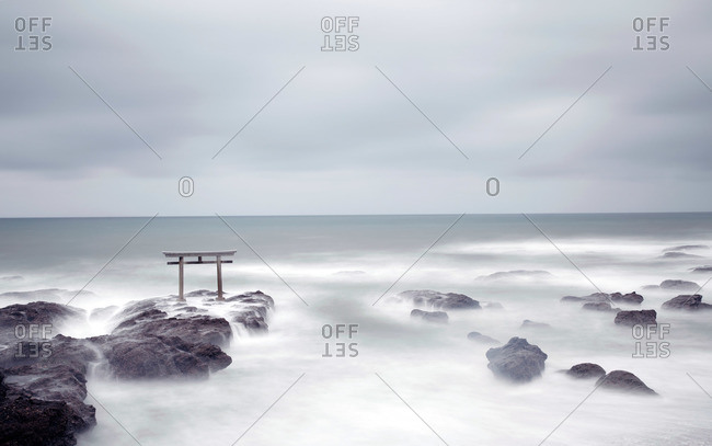 Torii gate on rocks in ocean, Oarai coast, Japan