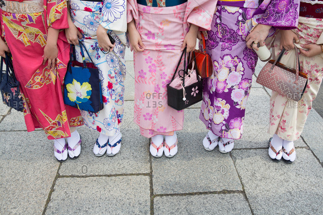 Five women in traditional Japanese kimono and footwear