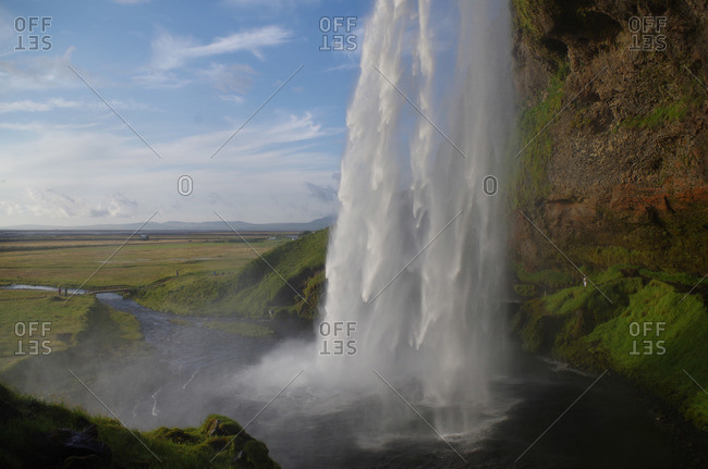 Side view of Seljalandsfoss waterfall in southern Iceland