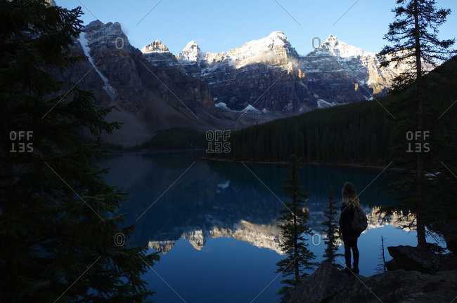 Woman overlooking Moraine Lake in Banff National Park, Canada