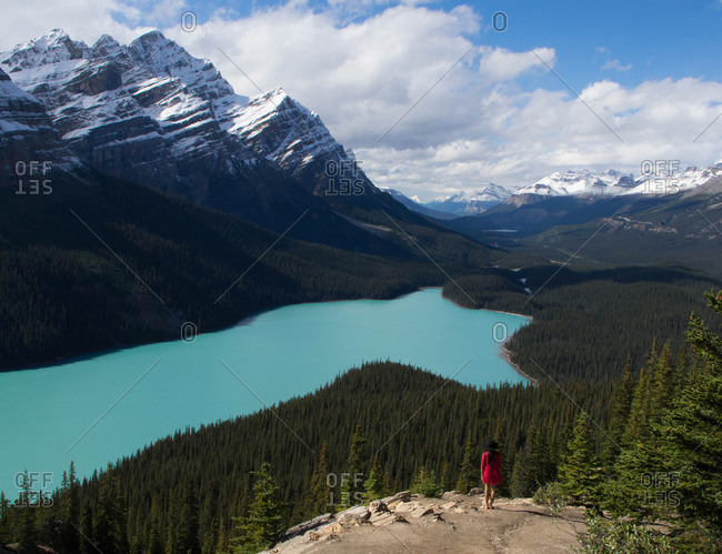 Woman overlooking blue glacial lake in Banff National Park, Canada