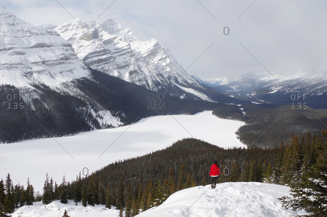 Woman overlooking lake in Banff National Park in winter