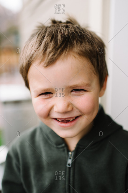 Little boy with a big toothless grin