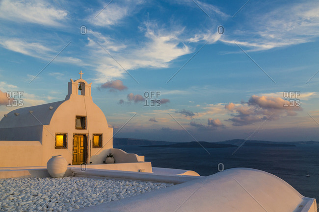 White church at sunset in Santorin, Greece