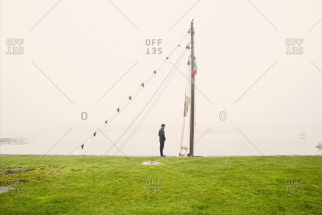 Man looking at mast of boat