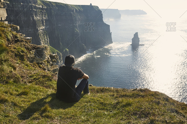 Man at Irish coastal cliffs