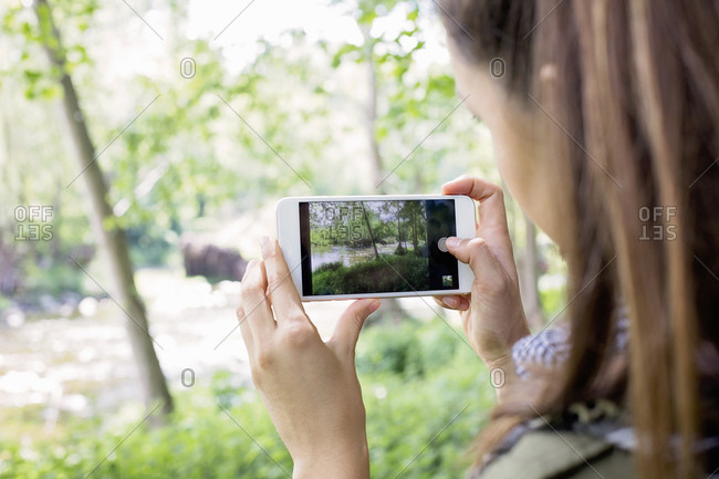 Woman taking picture of countryside