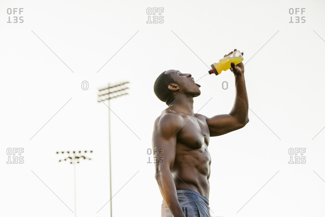 Male athlete hydrating