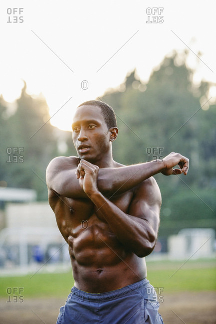 Portrait of male athlete stretching