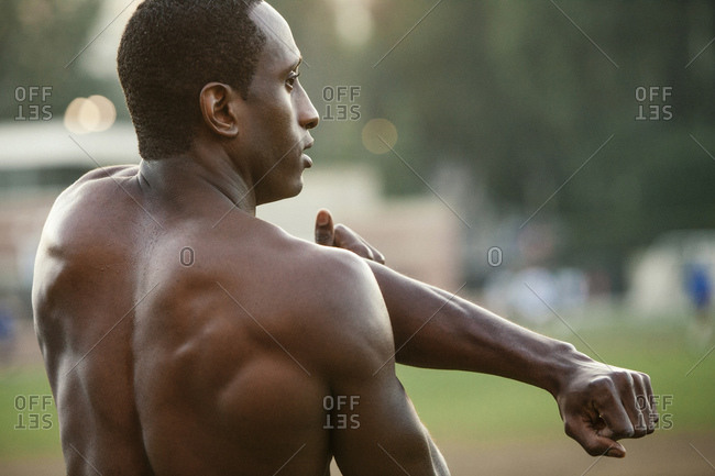 Male athlete stretching his shoulders