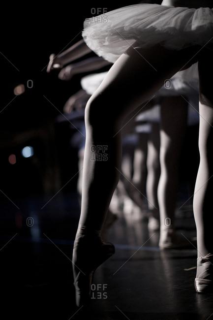 Detail ballerinas in tutus on stage