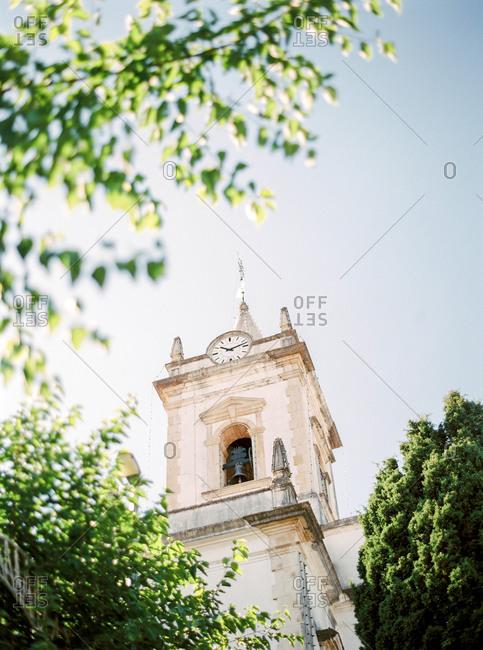 Upward view of clock tower on church