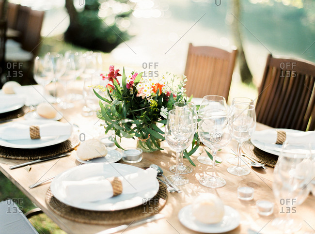 Elegant table set for outdoor wedding reception