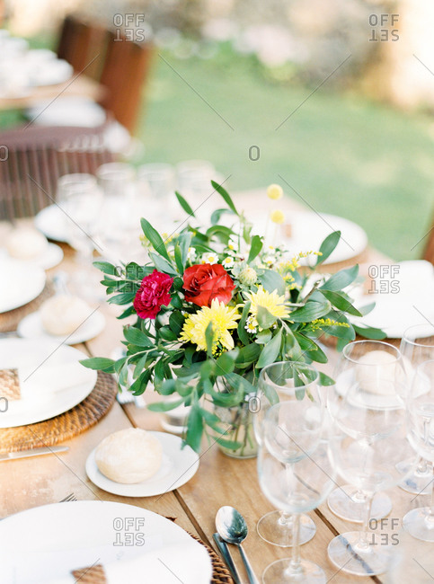 Red, yellow and green floral centerpiece on banquet table