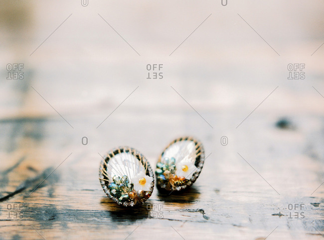 Close-up of vintage earrings with flower decorations