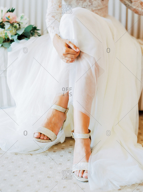 Bride's shoes and tulle skirt of wedding dress