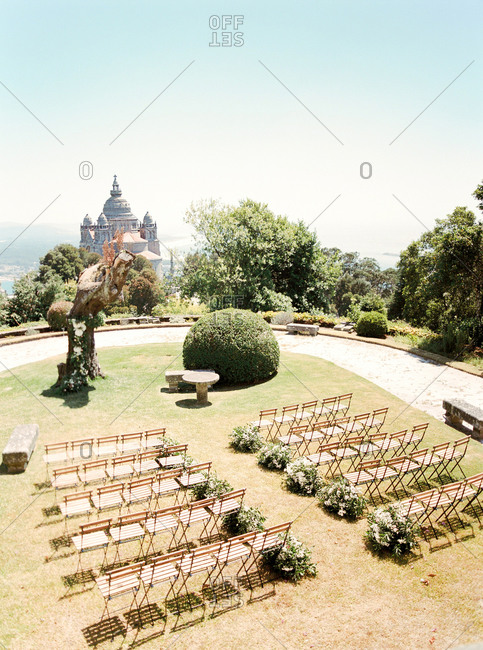 Overhead view of rows of chairs arranged in garden for wedding ceremony