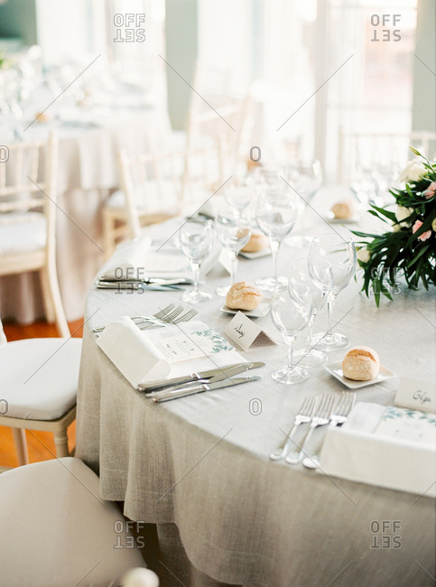Close-up of place settings on linen tablecloth