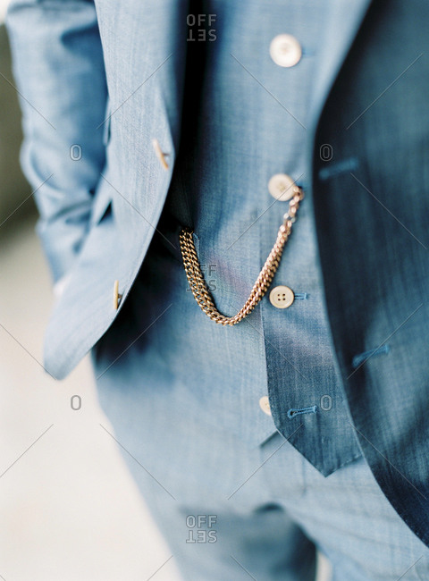 Close-up of man's watch chain in dress suit