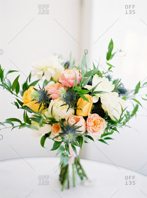 Wedding bouquet of yellow, pink and white flowers on table
