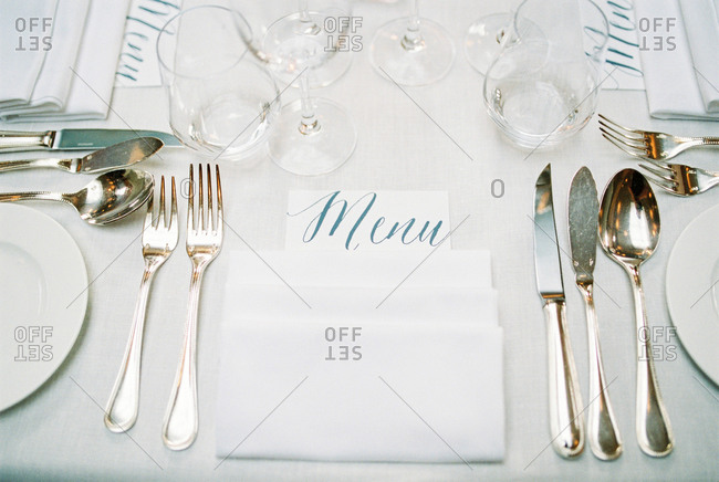 Close-up of menu card in napkin at wedding reception place setting