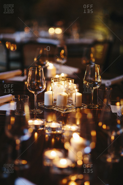 Candles and wine glasses on table at wedding reception
