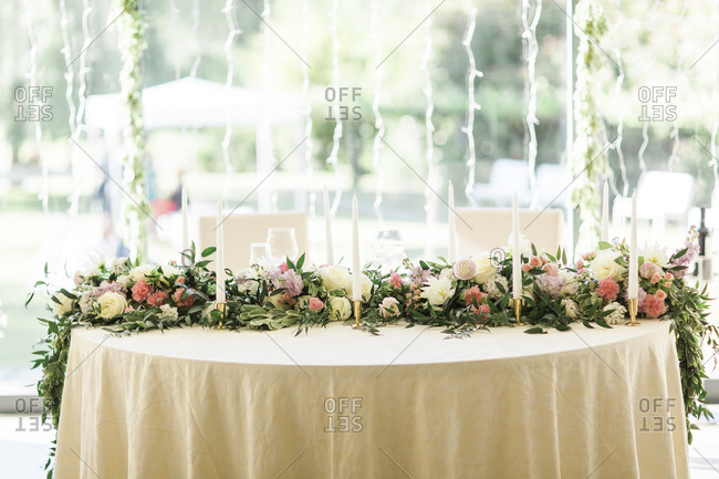 Table set with elegant garland of pink and white roses