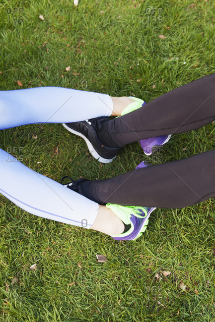 Athletic women with legs locked in a work out