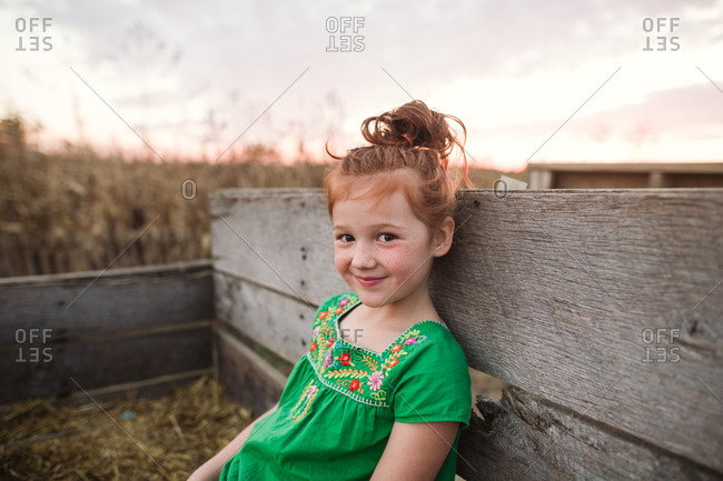 Little girl riding on a hay ride