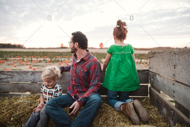 Father and kids riding on a hay ride