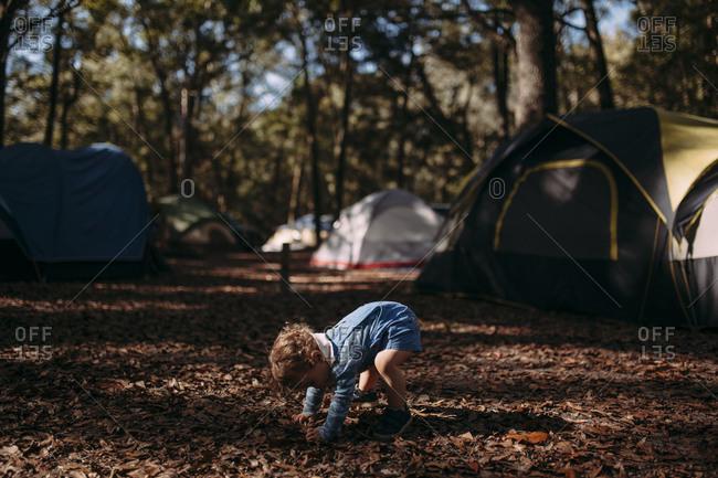 Toddler exploring a campground