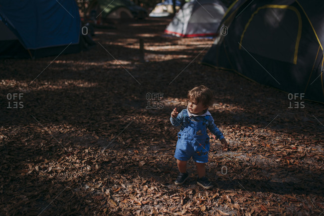 Toddler wandering through a campground