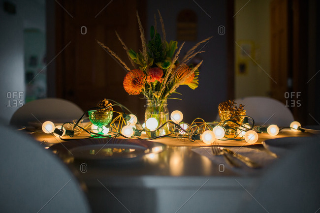 String of lights glowing on set table