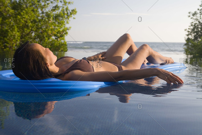 Woman Floating on a pool toy