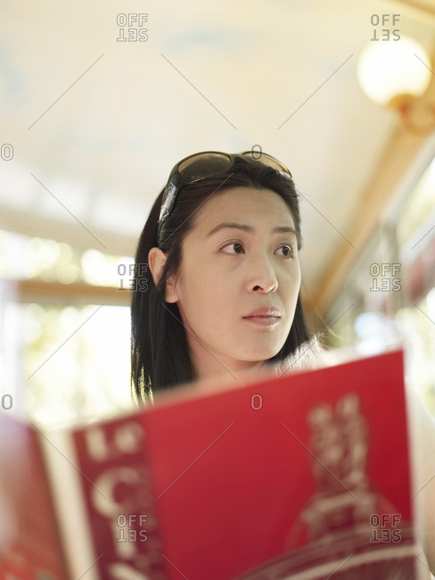 Woman distracted from a menu at a restaurant