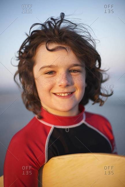 A smiling young surfer