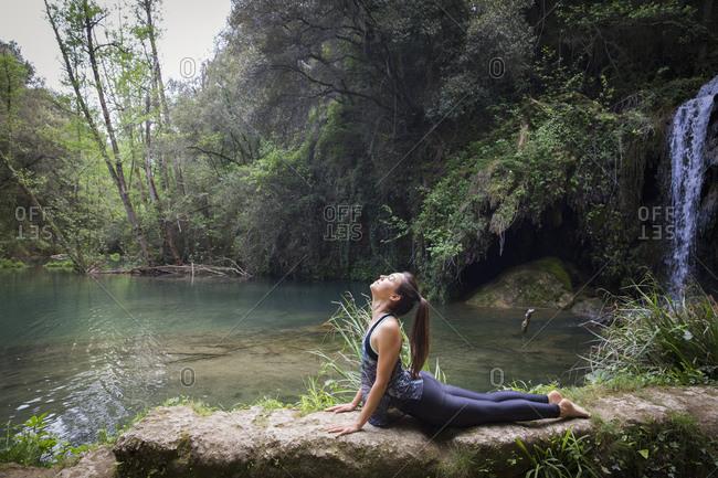 Woman in upward facing dog in scenic setting