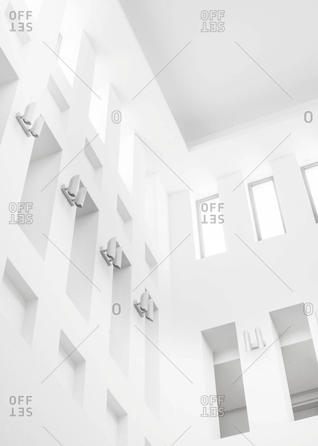Windows and lights in a building in black and white