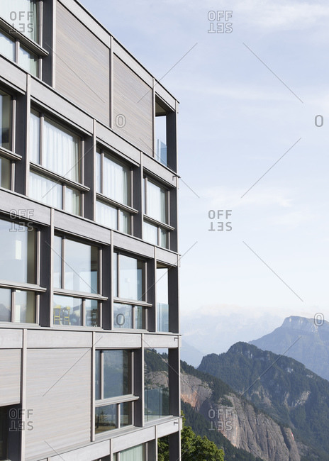 Building with reflections of mountains